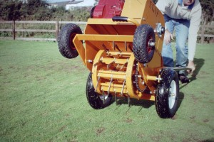 A motorised lawn aerator for grass aeration